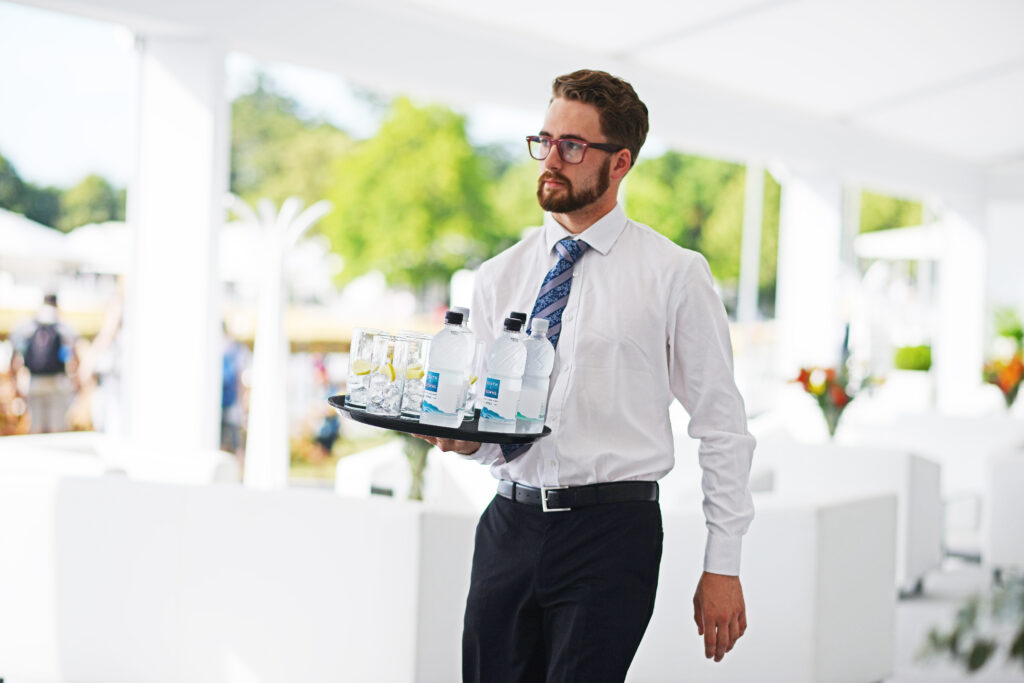 man carrying water at event